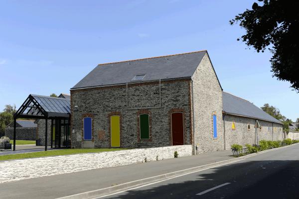 Rénovation de façade maison ancienne en pierre
